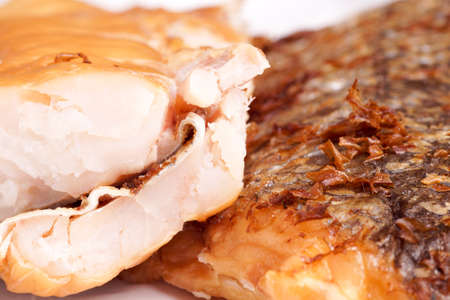 hake: Smoked Fish Hake Fillet. Close up of delicious smoked wild Hakes, ready for serving Stock Photo