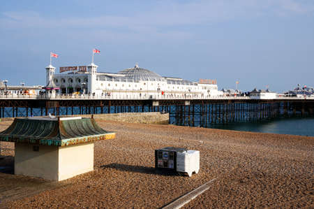 seaside town: BRIGHTON - AUGUST 2015: Brighton Pier in Brighton UK, on August 2015. People travel to the seaside town of Brighton to enjoy the beach, sea and the pier