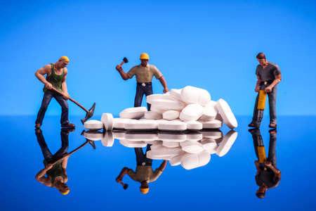 social work aged care: medicine and workmen, tablets medicine and workers, figurine isolated