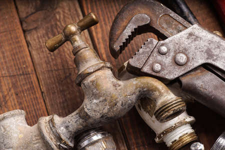 plumbing tools lying with old pipes and faucets Standard-Bild