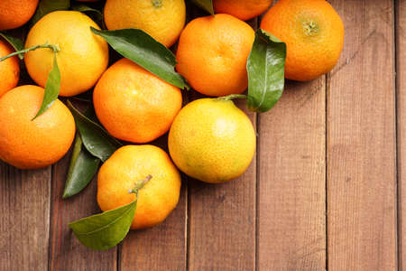 fresh organic clementines picked with green leaves Stock Photo