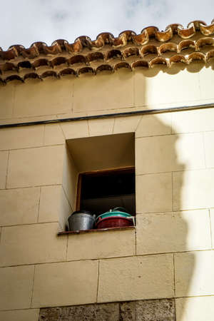 window opening: window opening with pots and pans in sunshine