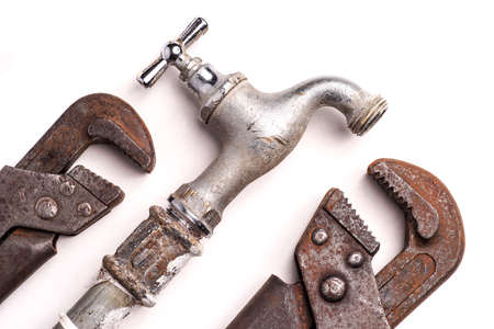 flexi: plumbing tools lying with old pipes and faucets Stock Photo