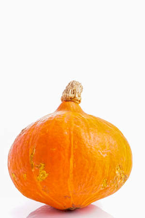 fruits background: Organic, Orange Hokkaido Pumpkin Vegetable isolated on white Stock Photo