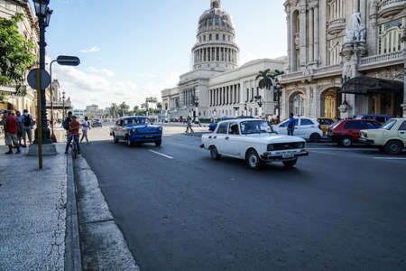 downtown capitol: HAVANA,CUBA - January 5, 2016 : Street scene with old american cars and other cars near the Capitol of Havana