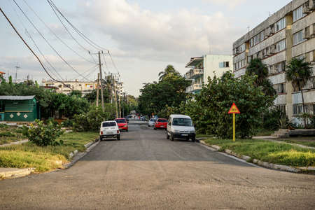 rundown: Havana, Cuba - January 7, 2016: Typical scene of one of streets in La Havana - poor residential area with apartments in the slum apartment buildings and cars parked on the street Editorial