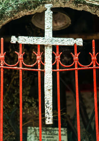 redemption: Religious White Cross  on red metal gate