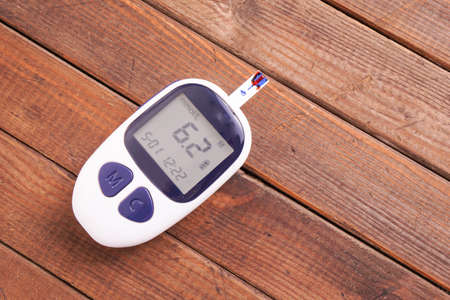 blood glucose: Blood glucose meter with blood drop measuring blood sugar