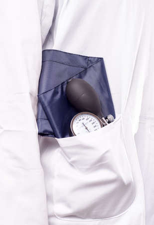 diastolic: Blood pressure gauge, sphygmomanometer, in the doctora lab coat, ready for use in the medical check up Stock Photo