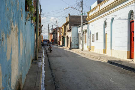 cuban culture: Typical scene of one of streets in the center of Santiago de cuba - Colorful architecture. Santiago is the 2nd largest city in Cuba