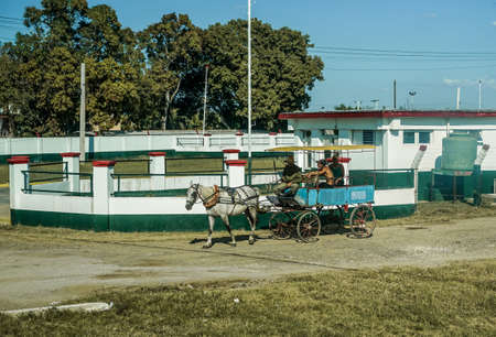 preferred: Trinidad, Cuba - January 12, 2016: Trinidads residents still use horse-drawn carriages as the preferred vehicle. Cuba has one of lowest vehicle per capita rates in the world