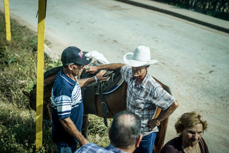 capita: Trinidad, Cuba - January 13, 2016: Trinidads residents still use horses for transportation. Cuba has one of lowest vehicle per capita rates in the world. In Cuba sits the local cowboys, Gaucho, in the saddle all day. They are a regular part of the local