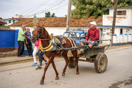 preferred: Trinidad, Cuba - January 14, 2016: Trinidads residents still use horse-drawn carriages as the preferred vehicle. Cuba has one of lowest vehicle per capita rates in the world