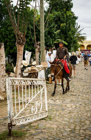 capita: Trinidad, Cuba - January 14, 2016: Trinidads residents still use horses for transportation. Cuba has one of lowest vehicle per capita rates in the world. In Cuba sits the local cowboys, Gaucho, in the saddle all day. They are a regular part of the local