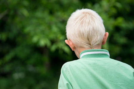 The head of the little blond boy in the Garden Stock Photo - 58986580