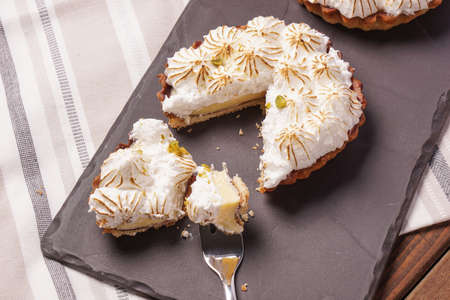 recipe decorated: Two Lemon meringue Pie with lime zest