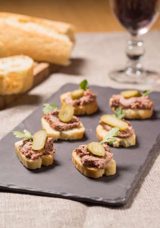 Appetizer with pate served on a Slate plate Stock Photo