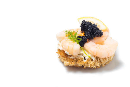Shrimp Appetizer served on toasted bread, isolated on white
