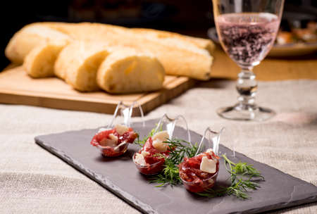 Appetizer with meat, Carpaccio and parmesan served on a Spoon