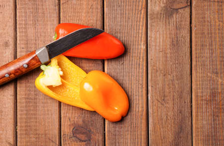 burlap sac: Small bell peppers in red and orange Stock Photo