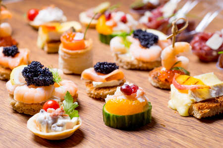 Exquisite selection of luxury canapes, appetizer ready to be served for events, celebrations or other occasion Stock Photo