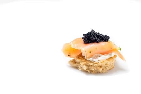 amuse: Smoked Salmon Appetizer with Cream Cheese and Caviar, isolated on white