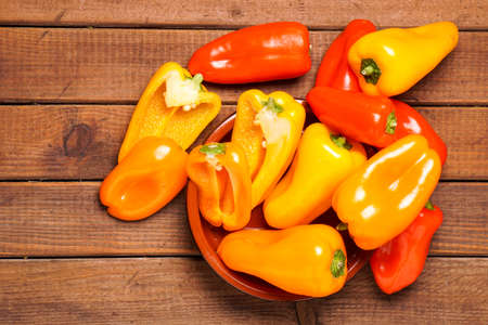 Small bell peppers in red and orange Stock Photo