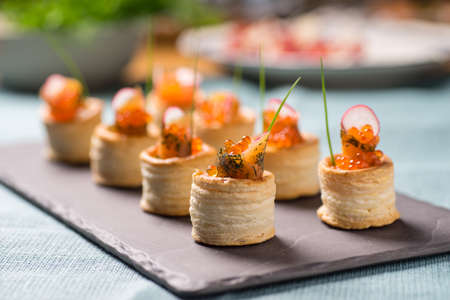 lax: Delicious appetizers with graved salmon and golden caviar served in puff pastry towers