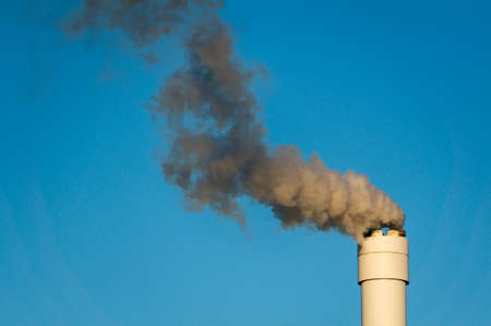 tall chimney: There will be polluted smoke against a clear blue sky from the tall chimney