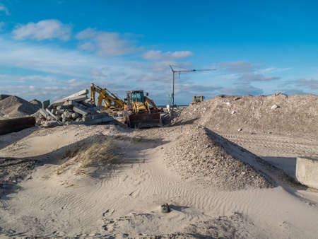 beach with construction work to shore safe from flooding and sand erosion in storm Stock Photo