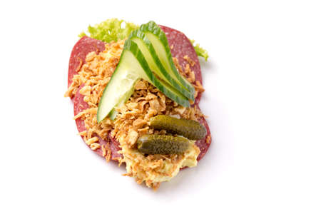 Danish specialties and national dishes, high-quality open sandwich, Salami with crispy fried onion, remoulade and cucumber isolated on white background