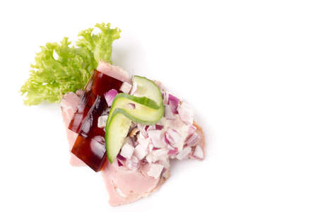 red onions: Danish specialties and national dishes, high-quality open sandwich. Sandwich with pork roll sausage, rullepoelse, , jelly and raw red onions, isolated on white background