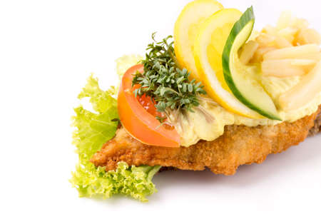 Danish specialties and national dishes, high-quality open sandwich, isolated on white background. fish fillet and garnished with remoulade and lemon Stock Photo