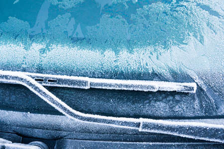 Iceflowers, frozen.The ice-cold frost forms ice crystals in beautiful unique patterns on the window, Hood and wiper on the Car