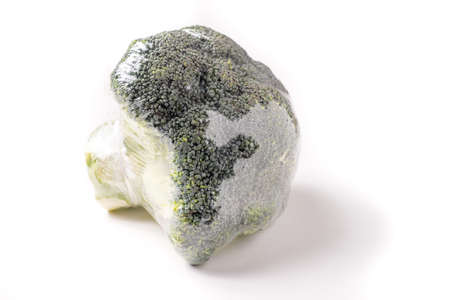 Organic Broccoli wrap in plastic, isolated on white background