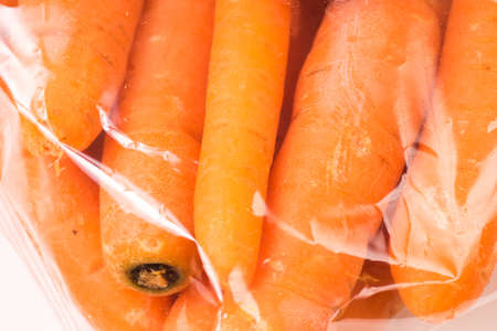 Bunch of organic Carrots packaged in plastic bag