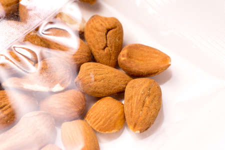 almonds packages in plastic packaging isoalted on white background