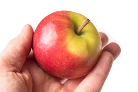 causasian hand holding apple isolated on white background Stock Photo