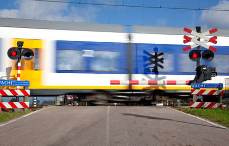 railroad crossing with high speed train Stock Photo - 8540483