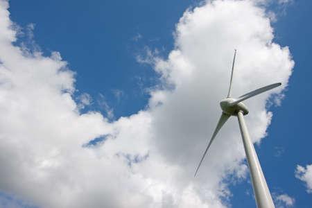 Windturbine of a blue sky and clouds