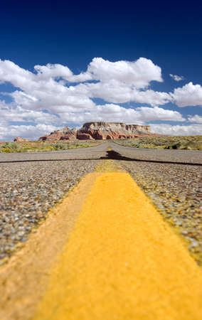 yellow stripes on long road Stock Photo