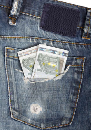 euro bills in a torn jeans pocket photo