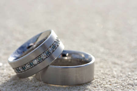 sand writing: Wedding rings