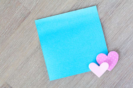 Blue post it note with little hearts