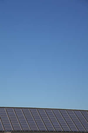 abstract view of solar panels with a clear blue sky photo