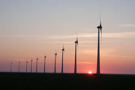 Silhouette of a Windfarm during sunset Stock Photo