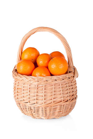 Basket of fresh oranges, mandarines or tangerines isolated on white background photo