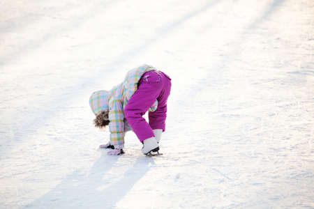 ice skates: Little child learning how to ice skate