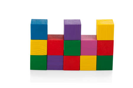 Wooden blocks, pyramid of colorful cubes, childrens toy isolated on white background photo