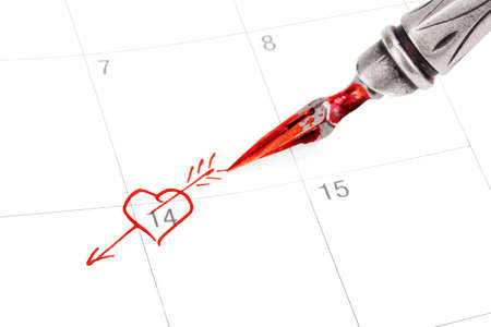 Calendar with Saint Valentines date marked out with ink pen photo